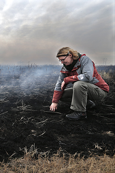 Kathryn Yurkonis observes a grassland fire science project