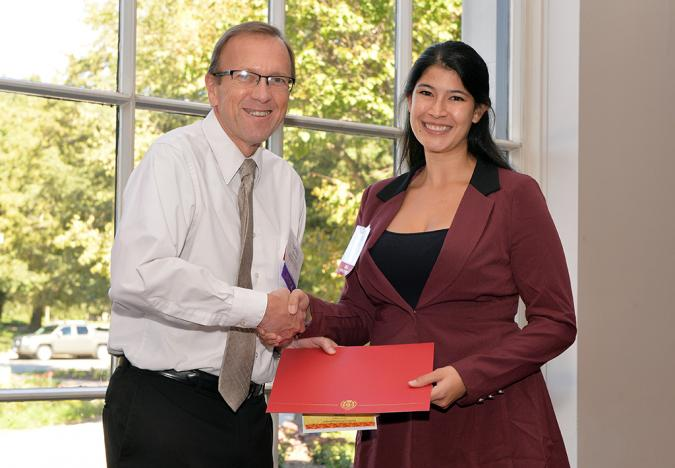 Daniela Flores accepts the Outstanding Presentation Award for the Biological Sciences during the Graduate Minority Assistantship Program (GMAP) annual symposium.